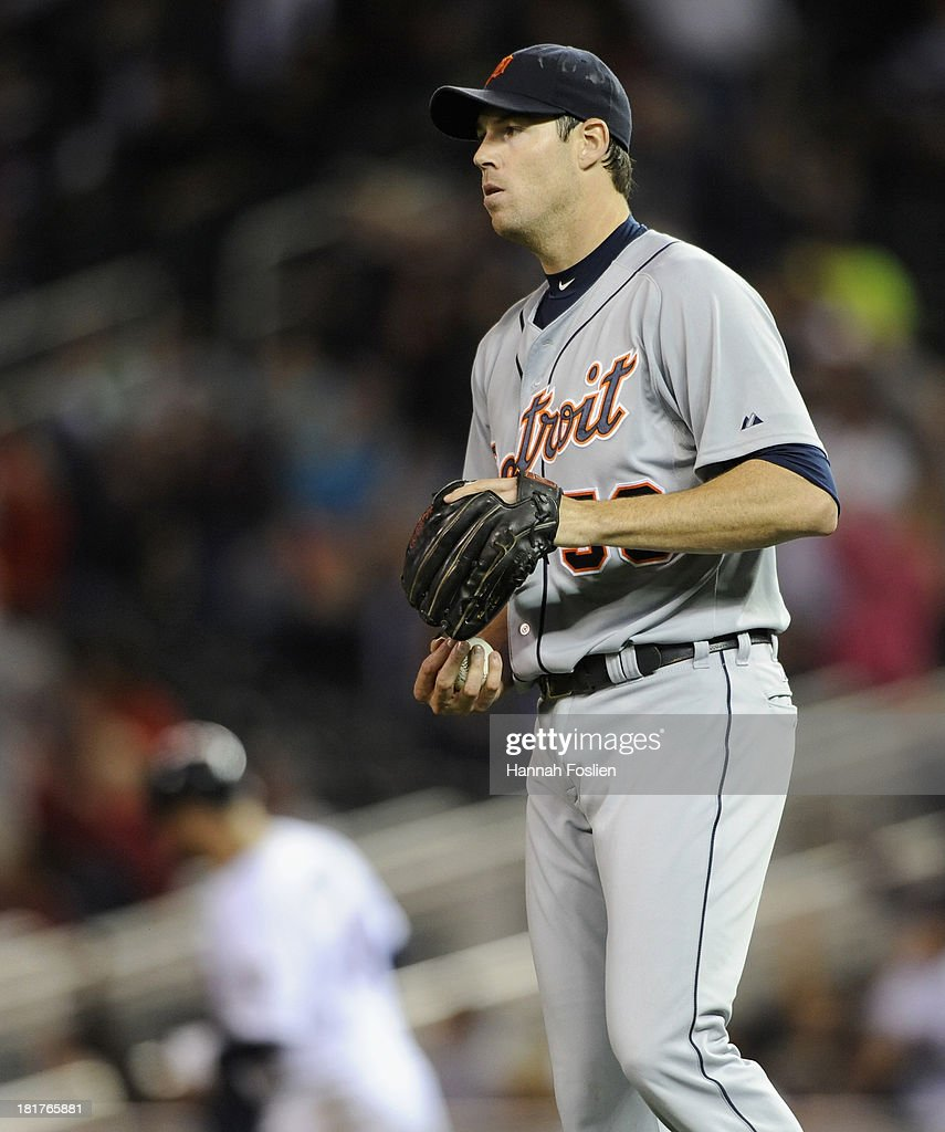<a gi-track='captionPersonalityLinkClicked' href=/galleries/search?phrase=Doug+Fister&family=editorial&specificpeople=6144840 ng-click='$event.stopPropagation()'>Doug Fister</a> #58 of the Detroit Tigers reacts as <a gi-track='captionPersonalityLinkClicked' href=/galleries/search?phrase=Ryan+Doumit&family=editorial&specificpeople=598785 ng-click='$event.stopPropagation()'>Ryan Doumit</a> #9 of the Minnesota Twins rounds the bases after hitting a solo home run during the seventh inning of the game on September 24, 2013 at Target Field in Minneapolis, Minnesota. The Tigers defeated the Twin 4-2.