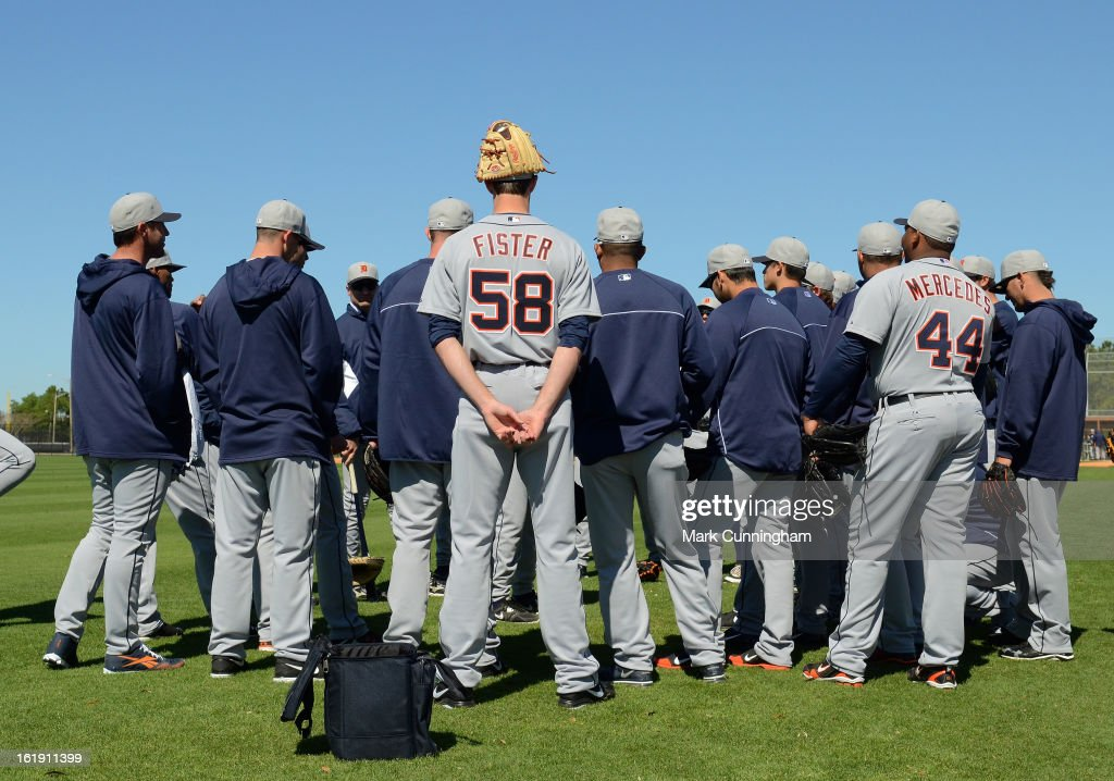 Doug Fister #58 of the Detroit Tigers stands with teammates during Spring Training workouts at the TigerTown Facility on February 17, 2013 in Lakeland, Florida.