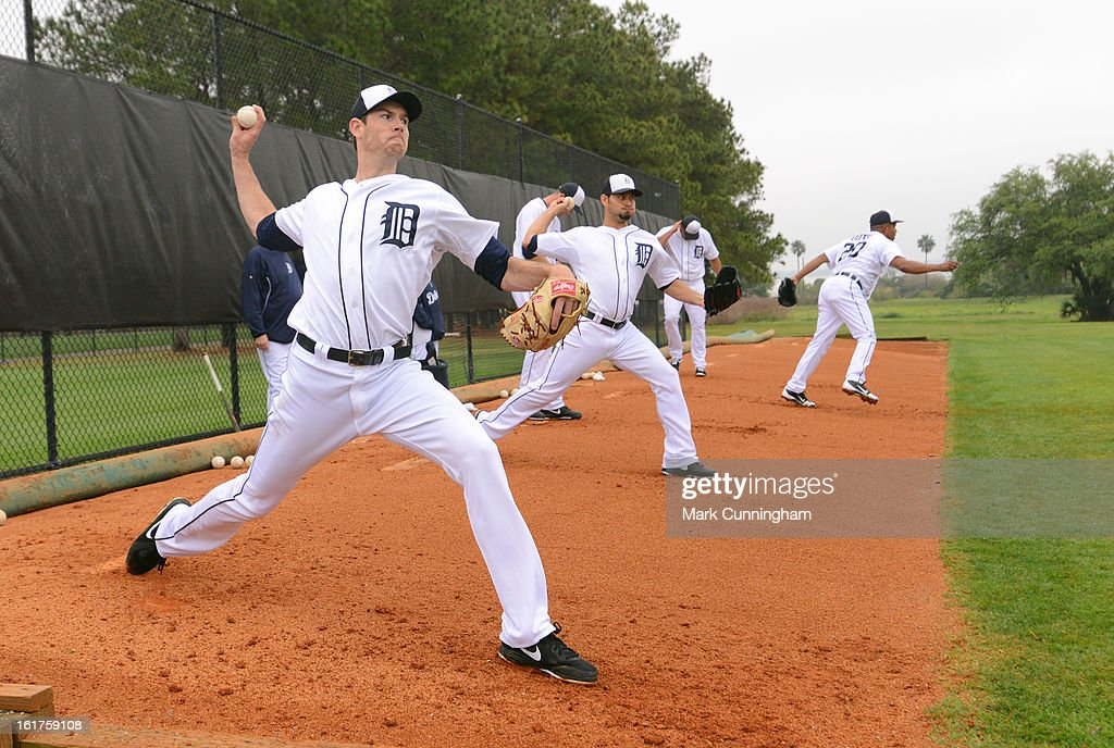 Doug Fister #58 (L) of the Detroit Tigers throws a pitch during Spring Training workouts at the TigerTown Facility on February 15, 2013 in Lakeland, Florida.