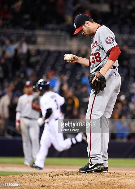 Doug Fister of the Washington Nationals stands on the mound as Derek Norris of the San Diego Padres rounds the bases after hitting a threerun home...
