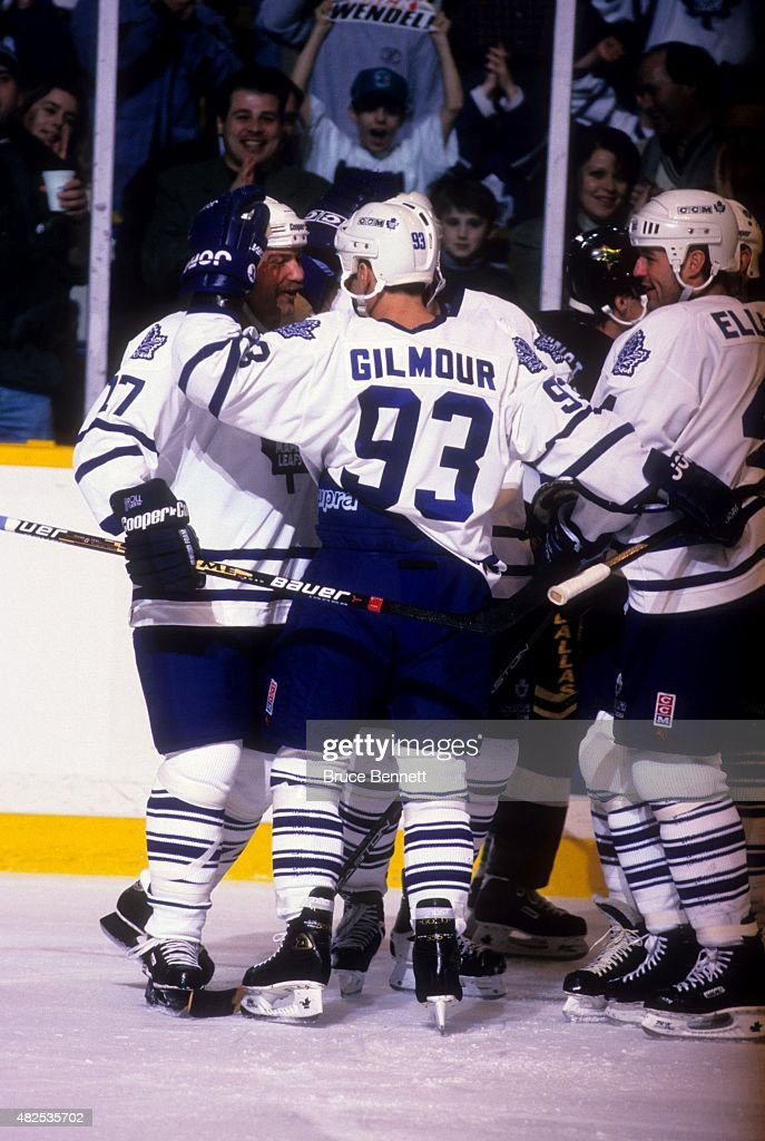 <a gi-track='captionPersonalityLinkClicked' href=/galleries/search?phrase=Doug+Gilmour&family=editorial&specificpeople=210813 ng-click='$event.stopPropagation()'>Doug Gilmour</a> #93 and Dave Ellett #4 of the Toronto Maple Leafs celebrate with <a gi-track='captionPersonalityLinkClicked' href=/galleries/search?phrase=Wendel+Clark&family=editorial&specificpeople=882632 ng-click='$event.stopPropagation()'>Wendel Clark</a> #17 after Clark scored during their game agaisnt the Dallas Stars on March 15, 1996 at the Maple Leaf Gardens in Toronto, Ontario, Canada.