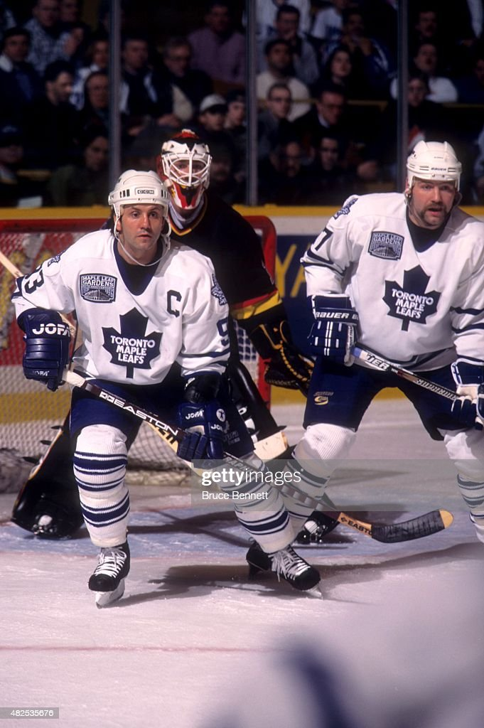 <a gi-track='captionPersonalityLinkClicked' href=/galleries/search?phrase=Doug+Gilmour&family=editorial&specificpeople=210813 ng-click='$event.stopPropagation()'>Doug Gilmour</a> #93 and <a gi-track='captionPersonalityLinkClicked' href=/galleries/search?phrase=Wendel+Clark&family=editorial&specificpeople=882632 ng-click='$event.stopPropagation()'>Wendel Clark</a> #17 of the Toronto Maple Leafs set up in front of goalie Kirk McLean #1 of the Vancouver Canucks on February 8, 1997 at the Maple Leaf Gardens in Toronto, Ontario, Canada.