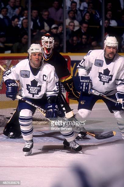 Doug Gilmour and Wendel Clark of the Toronto Maple Leafs set up in front of goalie Kirk McLean of the Vancouver Canucks on February 8 1997 at the...