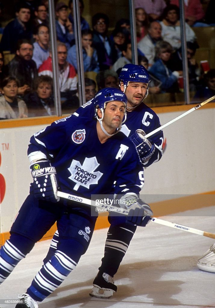 <a gi-track='captionPersonalityLinkClicked' href=/galleries/search?phrase=Doug+Gilmour&family=editorial&specificpeople=210813 ng-click='$event.stopPropagation()'>Doug Gilmour</a> #93 and <a gi-track='captionPersonalityLinkClicked' href=/galleries/search?phrase=Wendel+Clark&family=editorial&specificpeople=882632 ng-click='$event.stopPropagation()'>Wendel Clark</a> #17 of the Toronto Maple Leafs skate on the ice during an NHL game in October, 1992 at the Maple Leaf Gardens in Toronto, Ontario, Canada.