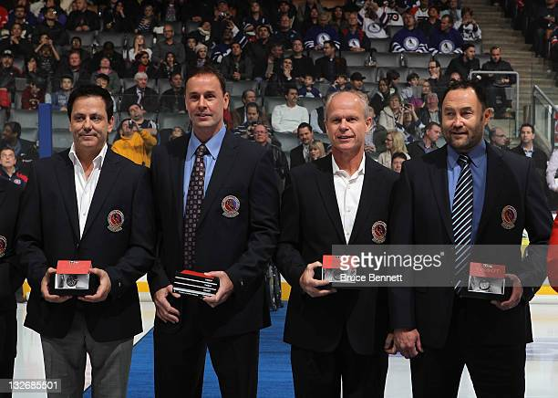 Doug Gilmour Joe Nieuwendyk Mark Howe and Ed Belfour show off their Hall of Fame jackets prior to a Legends of Hockey game at the Air Canada Centre...