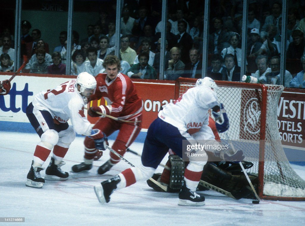 <a gi-track='captionPersonalityLinkClicked' href=/galleries/search?phrase=Doug+Gilmour&family=editorial&specificpeople=210813 ng-click='$event.stopPropagation()'>Doug Gilmour</a> #28 of Team Canada looks to shoot as his teammate Mike Gartner #12 looks for a rebound as Alexei Gusarov #3 of Team USSR defends during the 1987 Canada Cup on September 11, 1987 at the Montreal Forum in Montreal, Quebec, Canada.