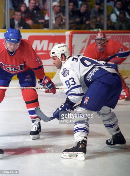 Doug Gilmour of the Toronto Maple Leafs prepares for a faceoff against Pierre Turgeon of the Montreal Canadiens during NHL Preseason game action on...