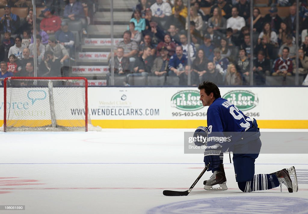 <a gi-track='captionPersonalityLinkClicked' href=/galleries/search?phrase=Doug+Gilmour&family=editorial&specificpeople=210813 ng-click='$event.stopPropagation()'>Doug Gilmour</a> skates in the Hockey Hall of Fame Legends Game at the Air Canada Centre on November 11, 2012 in Toronto, Canada.