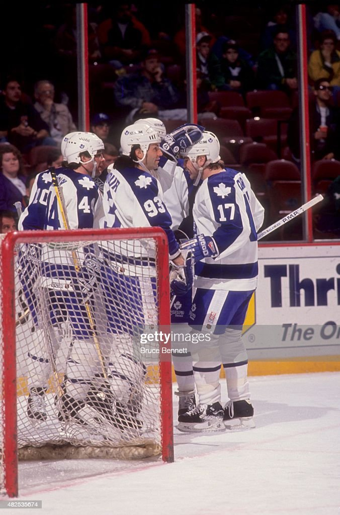 <a gi-track='captionPersonalityLinkClicked' href=/galleries/search?phrase=Doug+Gilmour&family=editorial&specificpeople=210813 ng-click='$event.stopPropagation()'>Doug Gilmour</a> #93, <a gi-track='captionPersonalityLinkClicked' href=/galleries/search?phrase=Wendel+Clark&family=editorial&specificpeople=882632 ng-click='$event.stopPropagation()'>Wendel Clark</a> #17 and Brian Bradley #44 of the Toronto Maple Leafs celebrate a goal during an NHL game against the Philadelphia Flyers on April 13, 1992 at the Spectrum in Philadelphia, Pennsylvania.