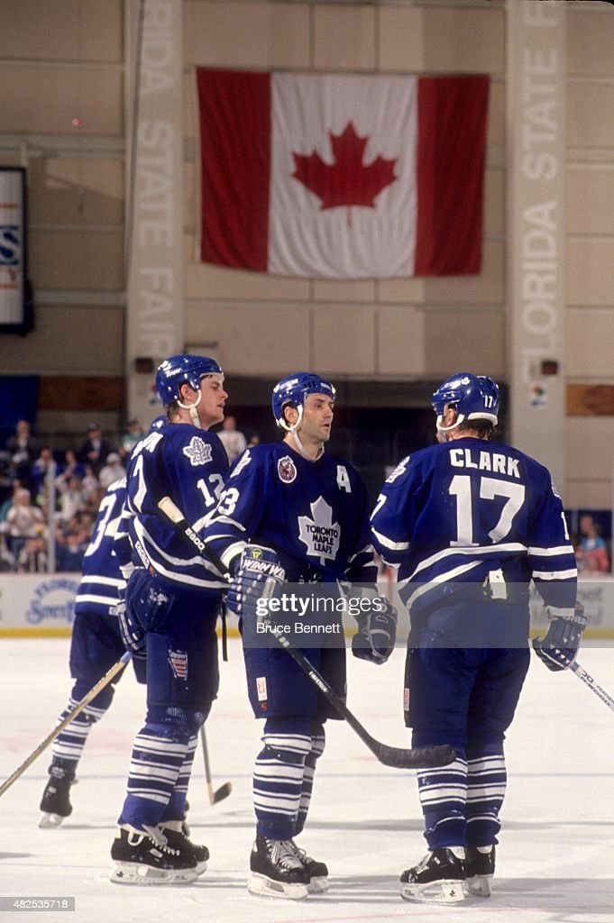 <a gi-track='captionPersonalityLinkClicked' href=/galleries/search?phrase=Doug+Gilmour&family=editorial&specificpeople=210813 ng-click='$event.stopPropagation()'>Doug Gilmour</a> #93, <a gi-track='captionPersonalityLinkClicked' href=/galleries/search?phrase=Wendel+Clark&family=editorial&specificpeople=882632 ng-click='$event.stopPropagation()'>Wendel Clark</a> #17 and Rob Pearson #12 of the Toronto Maple Leafs talk on the ice during an NHL game against the Tampa Bay Lightning on March 18, 1993 at the Expo Hall in Tampa, Florida.