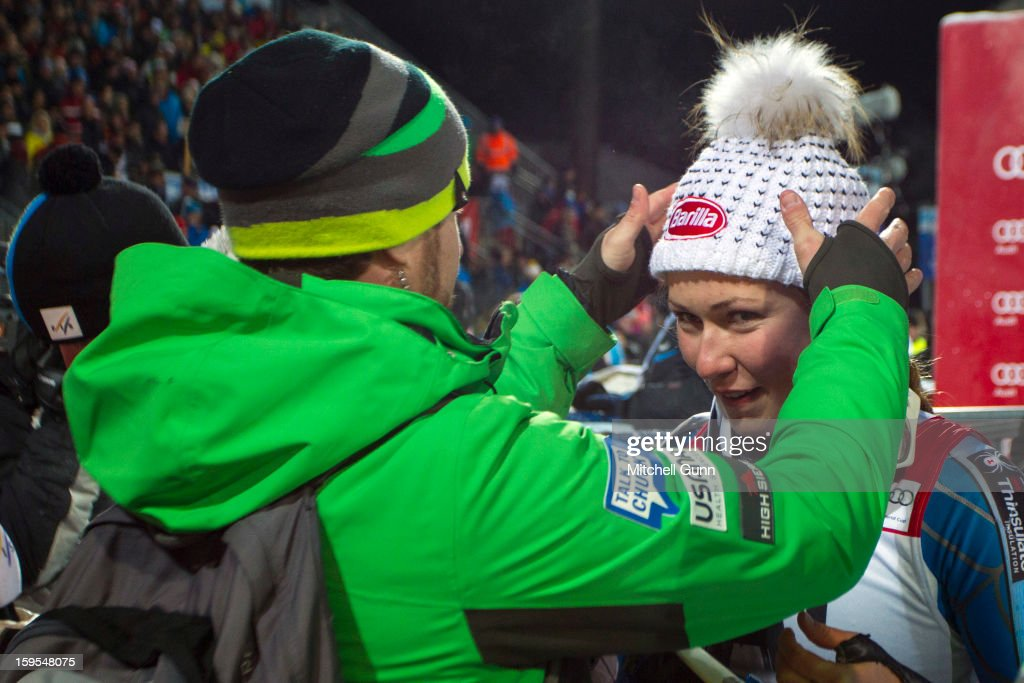 Doug Haney, US Ski Team Press officer, prepares Mikaela Shiffrin of the USA prior a tv interview after winning the Audi FIS Alpine Ski World Cup Slalom race on January 15, 2013 in Flachau, Austria.