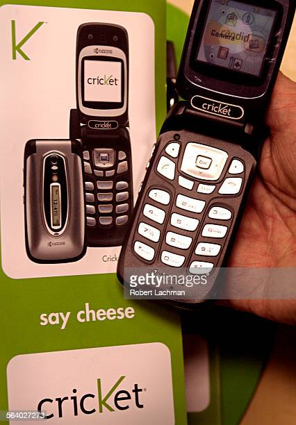 Doug Hutcheson president and chief executive officer of Leap Wireless International is photographed holding a phone from a Cricket wireless display...
