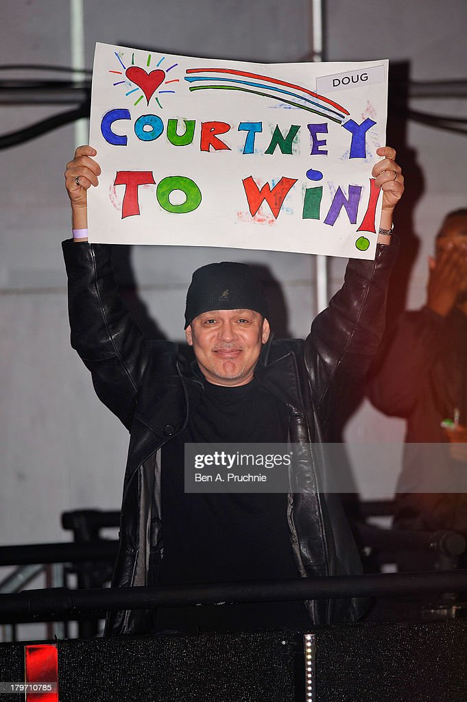 Doug Hutchison holds up a poster in support of his wife, Big Brother housemate Courtney Stodden, as Dustin Diamond is evicted from the Celebrity Big Brother house at Elstree Studios on September 6, 2013 in Borehamwood, England.
