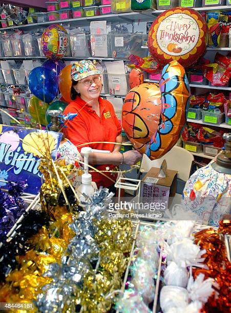 Doug Jones/Staff Photographer Tuesday November 7 2007 Jeannine Jarry fills helium balloons at Party Castles in Biddeford