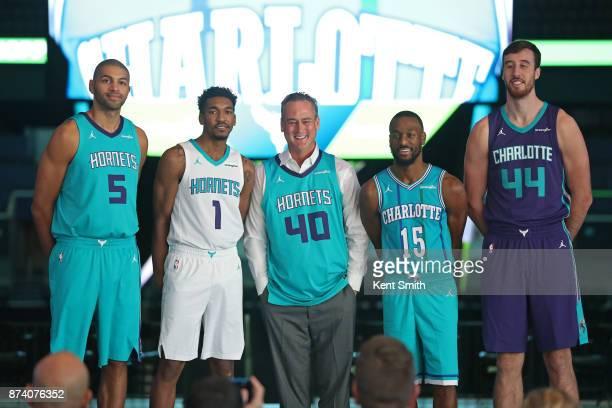 Doug Lebda founder and CEO of LendingTree and Nicolas Batum Malik Monk Kemba Walker and Frank Kaminsky of the Charlotte Hornets announce jersey patch...