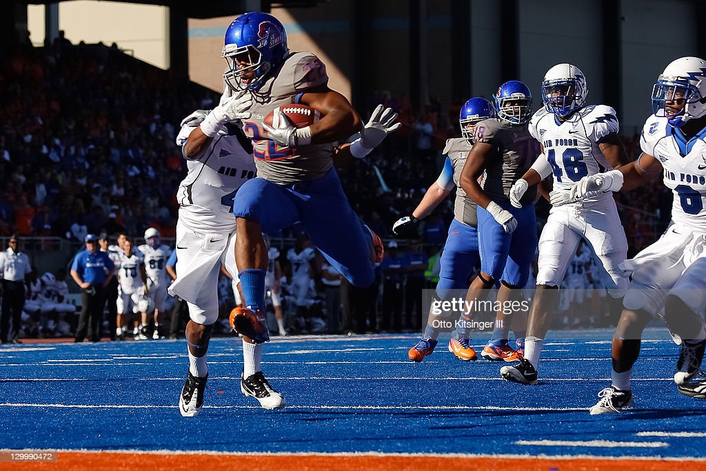 Doug Martin of the Boise State Broncos leaps into the end zone for a touchdown against the Air Force Falcons at Bronco Stadium on October 22 2011 in...