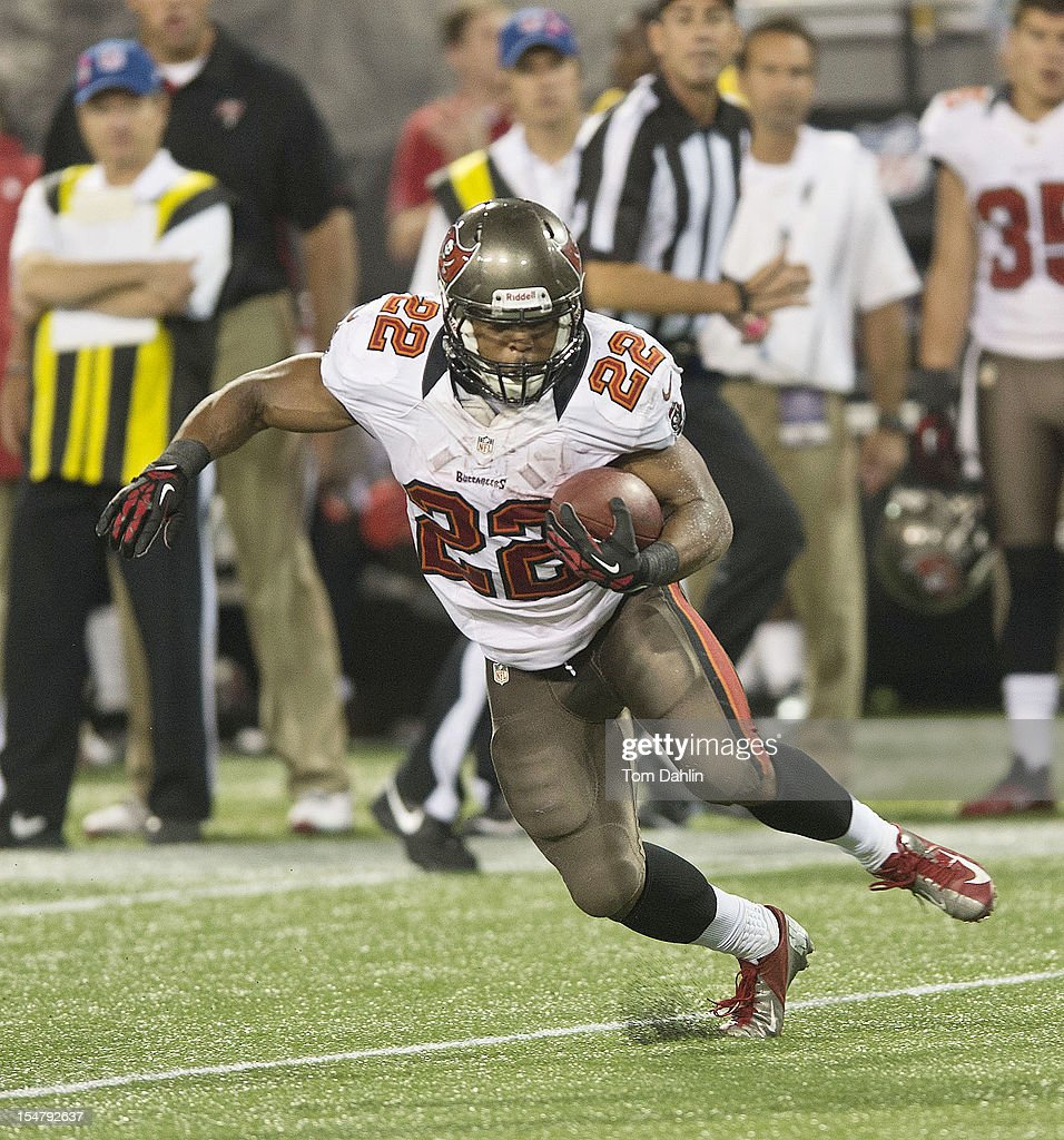 Doug Martin #22 of the Tampa Bay Buccaneers carries the ball during an NFL game against the Minnesota Vikings at Mall of America Field at the Hubert H. Humphrey Metrodome on October 25, 2012 in Minneapolis, Minnesota.