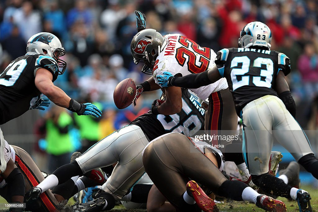 Doug Martin #22 of the Tampa Bay Buccaneers fumbles on the goal line late in the 4th quarter during their game against the Carolina Panthers at Bank of America Stadium on November 18, 2012 in Charlotte, North Carolina.