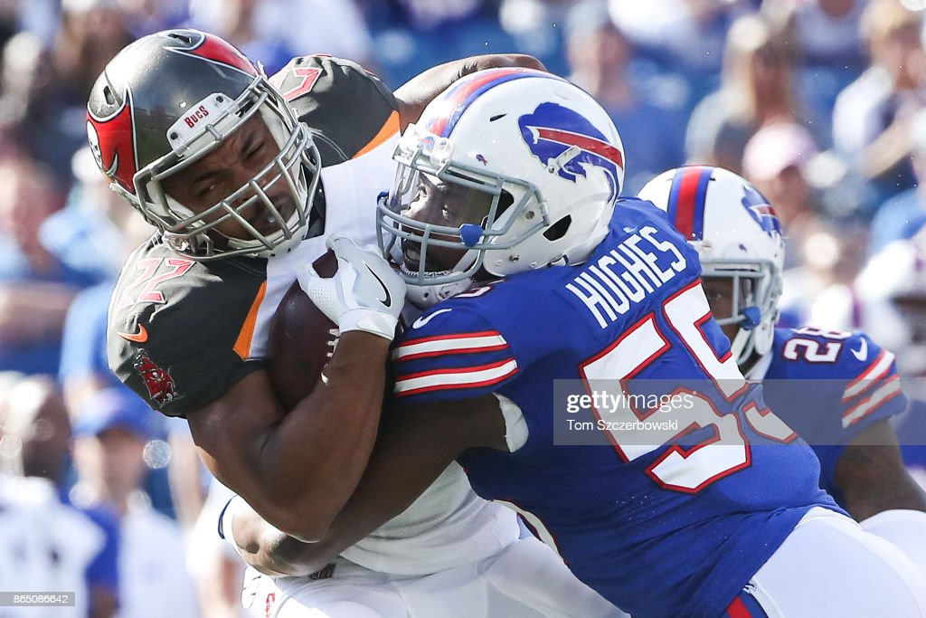 Doug Martin #22 of the Tampa Bay Buccaneers is tackled by Jerry Hughes #55 of the Buffalo Bills during an NFL game on October 22, 2017 at New Era Field in Orchard Park, New York.