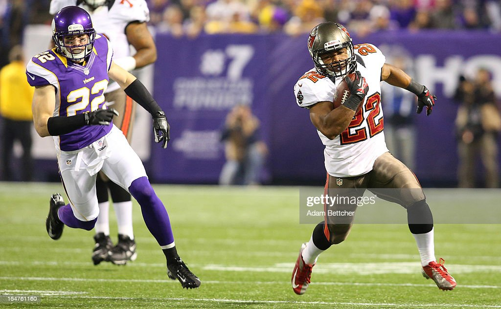 Doug Martin #22 of the Tampa Bay Buccaneers outruns Harrison Smith #22 of the Minnesota Vikings for a gain at the Hubert H. Humphrey Metrodome on October 25, 2012 in Minneapolis, Minnesota.