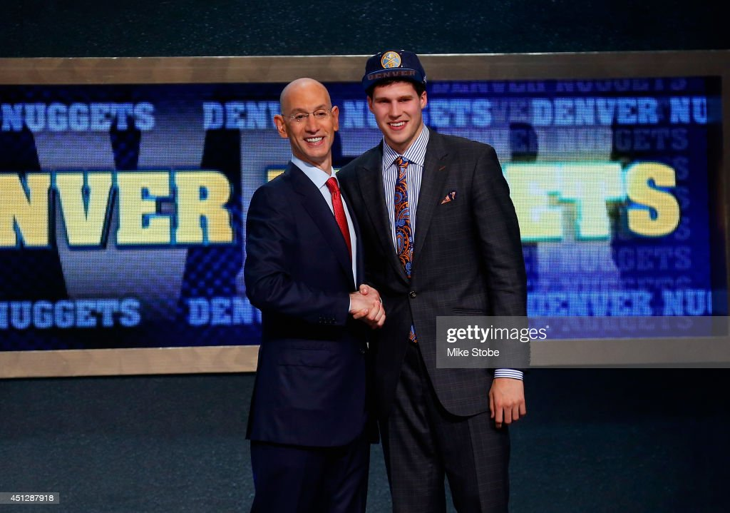 Doug McDermott of Creighton (R) shakes hands with NBA Commissioner Adam Silver after being drafted with the #11 overall pick by the Denver Nuggets during the 2014 NBA Draft at Barclays Center on June 26, 2014 in the Brooklyn borough of New York City.