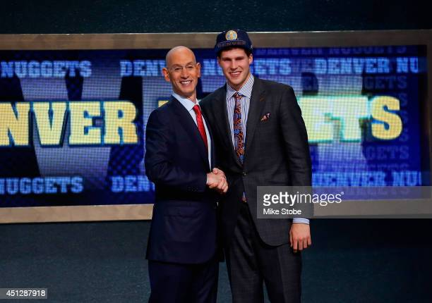 Doug McDermott of Creighton shakes hands with NBA Commissioner Adam Silver after being drafted with the overall pick by the Denver Nuggets during the...