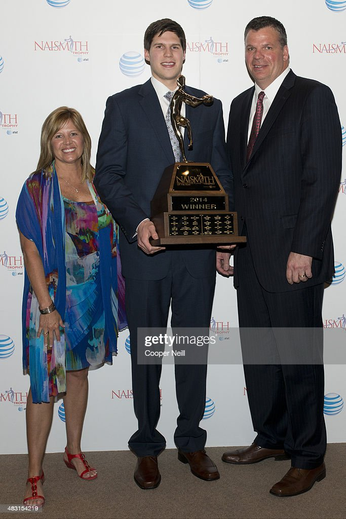 Doug McDermott of Creighton University poses with his mother, Theresa McDermott, and his father/coach Greg McDermott after winning the 2014 Men's Naismith Trophy during the AT&T NABC Guardians of the Game Awards Show at the Music Hall at Fair Park on April 6, 2014 in Dallas, Texas.
