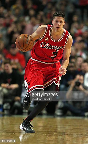 Doug McDermott of the Chicago Bulls advances the ball against the Toronto Raptors at the United Center on February 19 2016 in Chicago Illinois The...