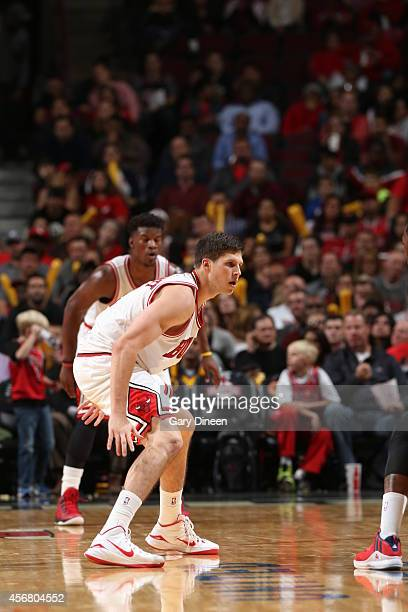 Doug McDermott of the Chicago Bulls defends against the Washington Wizards on October 6 2014 at the United Center in Chicago Illinois NOTE TO USER...