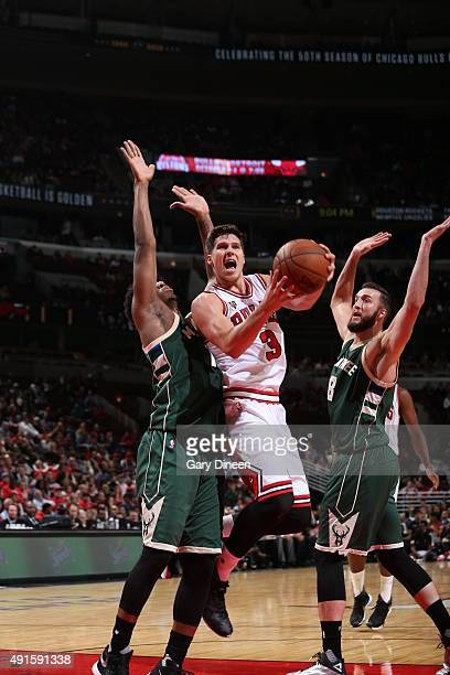 Doug McDermott of the Chicago Bulls goes to the basket against the Milwaukee Bucks during a preseason game on October 6 2015 at the United Center in...
