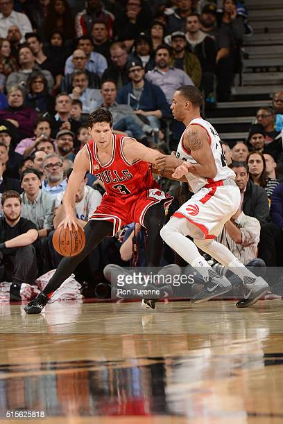 Doug McDermott of the Chicago Bulls handles the ball against the Toronto Raptors on March 14 2016 at the Air Canada Centre in Toronto Ontario Canada...