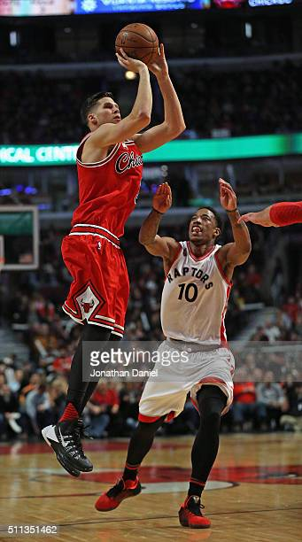 Doug McDermott of the Chicago Bulls puts up a shot over DeMar DeRozan of the Toronto Raptors on his way to a gamehigh 30 points at the United Center...