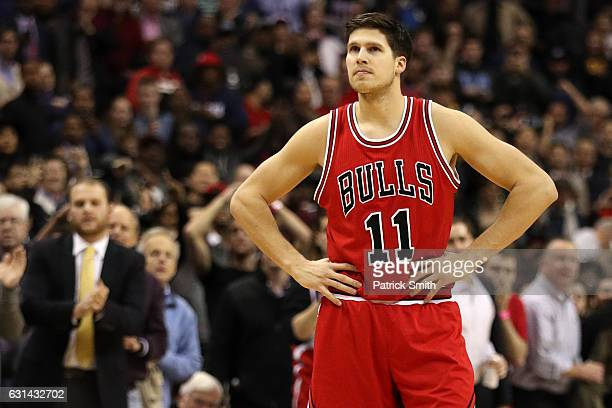 Doug McDermott of the Chicago Bulls reacts after missing a shot against the Washington Wizards in the fourth quarter at Verizon Center on January 10...