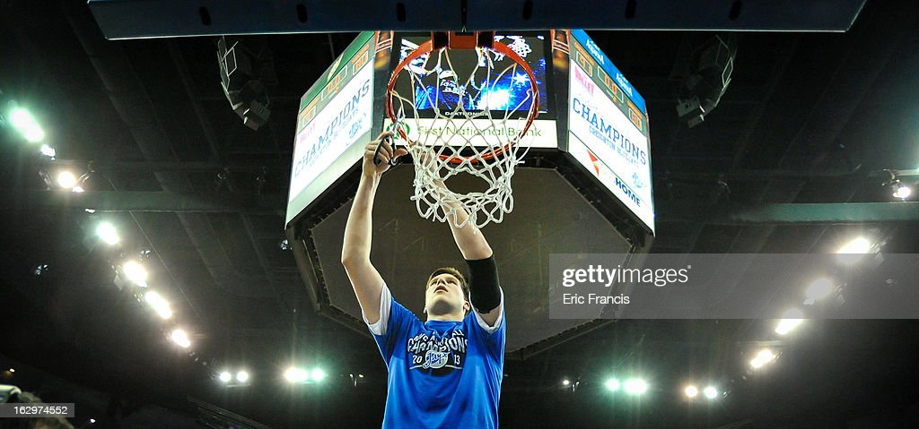 Doug McDermott #3 of the Creighton Bluejays cuts down a piece of the net after the Creighton Bluejays won the Missouri Valley Canference season title during their game against the Wichita State Shockers at the CenturyLink Center on March 2, 2013 in Omaha, Nebraska.