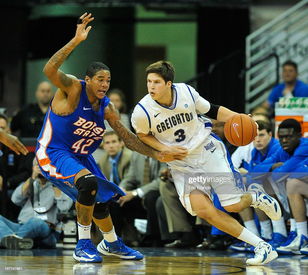 Doug McDermott #3 of the Creighton Bluejays drives against Darrious Hamilton #24 of the Boise State Broncos during their game at CenturyLink Center on November 28, 2012 in Omaha, Nebraska. Boise State beat Creighton 83-70.