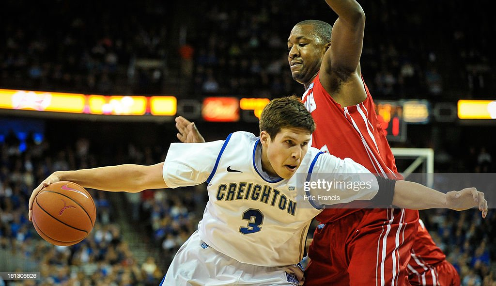 Doug McDermott #3 of the Creighton Bluejays drives past John Wilkins #13 of the Illinois State Redbirds during their game at the CenturyLink Center on February 9, 2013 in Omaha, Nebraska.