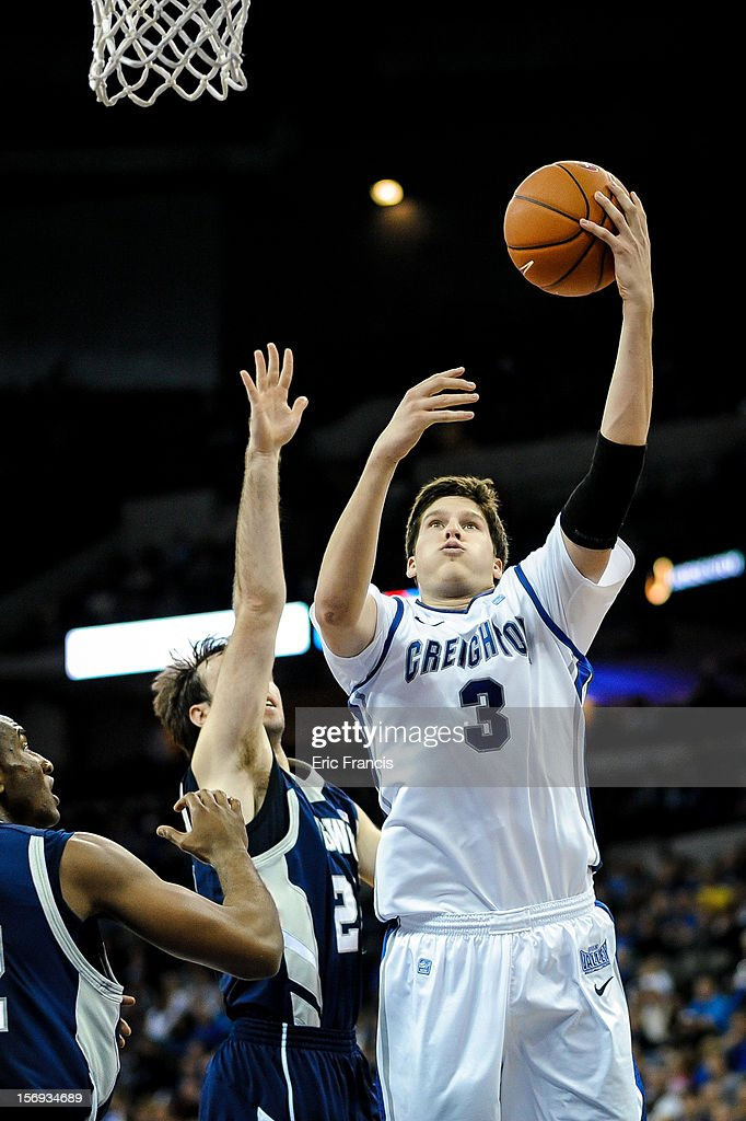 Doug McDermott #3 of the Creighton Bluejays drives to the hoops past Karl Ziegler #20 and Jeylani Dublin #22 of the Longwood Lancers during their game at CenturyLink Center on November 20, 2012 in Omaha, Nebraska.