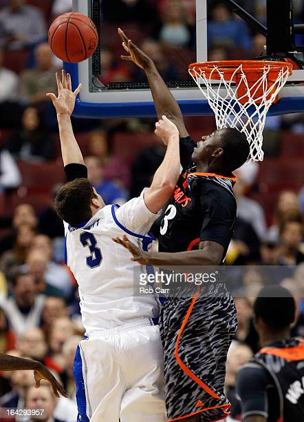 Doug McDermott of the Creighton Bluejays goes up for shoot against Cheikh Mbodj of the Cincinnati Bearcats in the first half during the second round...