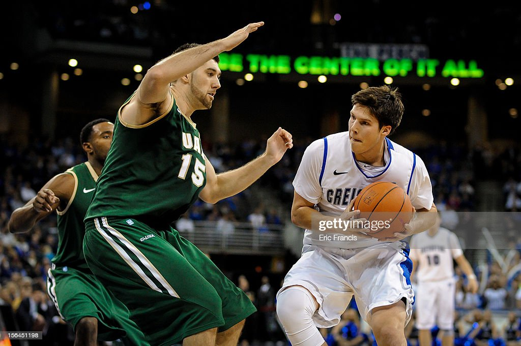 Doug McDermott #3 of the Creighton Bluejays looks for an opportunity against Fahro Alihodzic #15 of the UAB Blazers during their game at CenturyLink Center on November 14, 2012 in Omaha, Nebraska. Creighton beat UAB