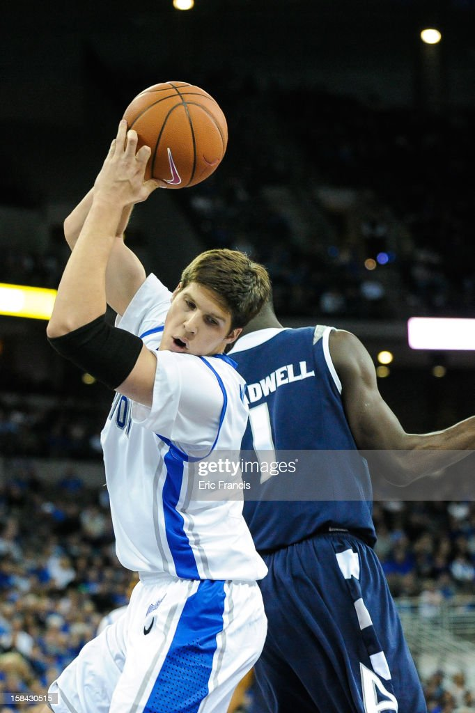 Doug McDermott #3 of the Creighton Bluejays pulls in a rebound during their game against the Akron Zips at the CenturyLink Center on December 9, 2012 in Omaha, Nebraska. Creighton defeated Akron 77-61.