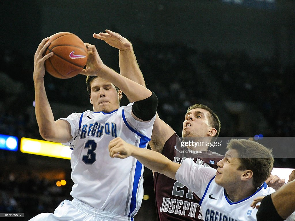 Doug McDermott #3 of the Creighton Bluejays pulls in a rebound over Halil Kanacevic #21 of the Saint Joseph's Hawks during their game at CenturyLink Center on December 1, 2012 in Omaha, Nebraska.
