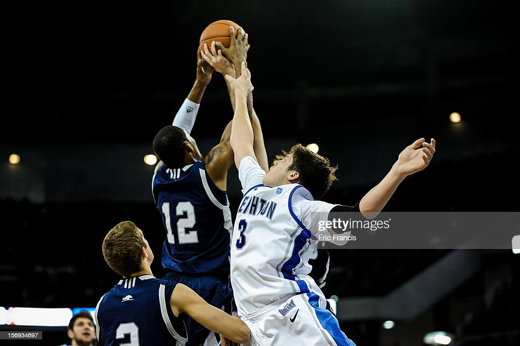 Doug McDermott #3 of the Creighton Bluejays reaches for a rebound with Tristan Carey #12 of the Longwood Lancers during their game at CenturyLink Center on November 20, 2012 in Omaha, Nebraska.
