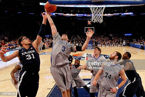 Doug McDermott of the Creighton Bluejays rebounds over Isaiah Philmore of the Xavier Musketeers in the second half during the Semifinals of the 2014...