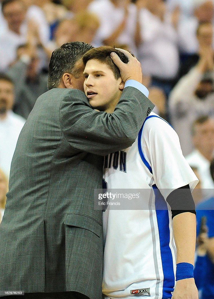 <a gi-track='captionPersonalityLinkClicked' href=/galleries/search?phrase=Doug+McDermott&family=editorial&specificpeople=7544468 ng-click='$event.stopPropagation()'>Doug McDermott</a> #3 of the Creighton Bluejays receives a hug from his father head coach <a gi-track='captionPersonalityLinkClicked' href=/galleries/search?phrase=Greg+McDermott&family=editorial&specificpeople=803538 ng-click='$event.stopPropagation()'>Greg McDermott</a> of the Creighton Bluejays during the final seconds of their game at against the Wichita State Shockers the CenturyLink Center on March 2, 2013 in Omaha, Nebraska.