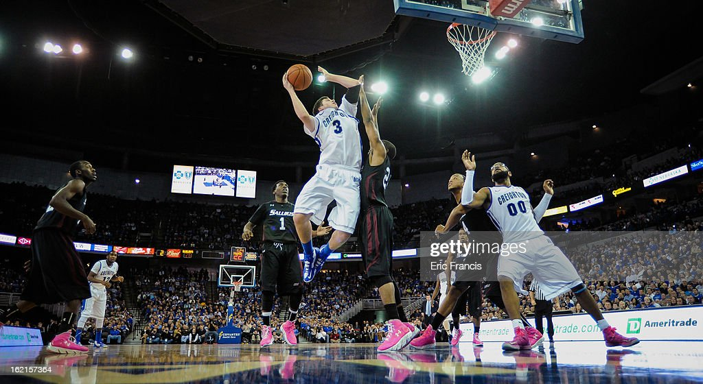 <a gi-track='captionPersonalityLinkClicked' href=/galleries/search?phrase=Doug+McDermott&family=editorial&specificpeople=7544468 ng-click='$event.stopPropagation()'>Doug McDermott</a> #3 of the Creighton Bluejays shoots over Jeff Early #22 of the Southern Illinois Salukis during their game at the CenturyLink Center on February 19, 2013 in Omaha, Nebraska.