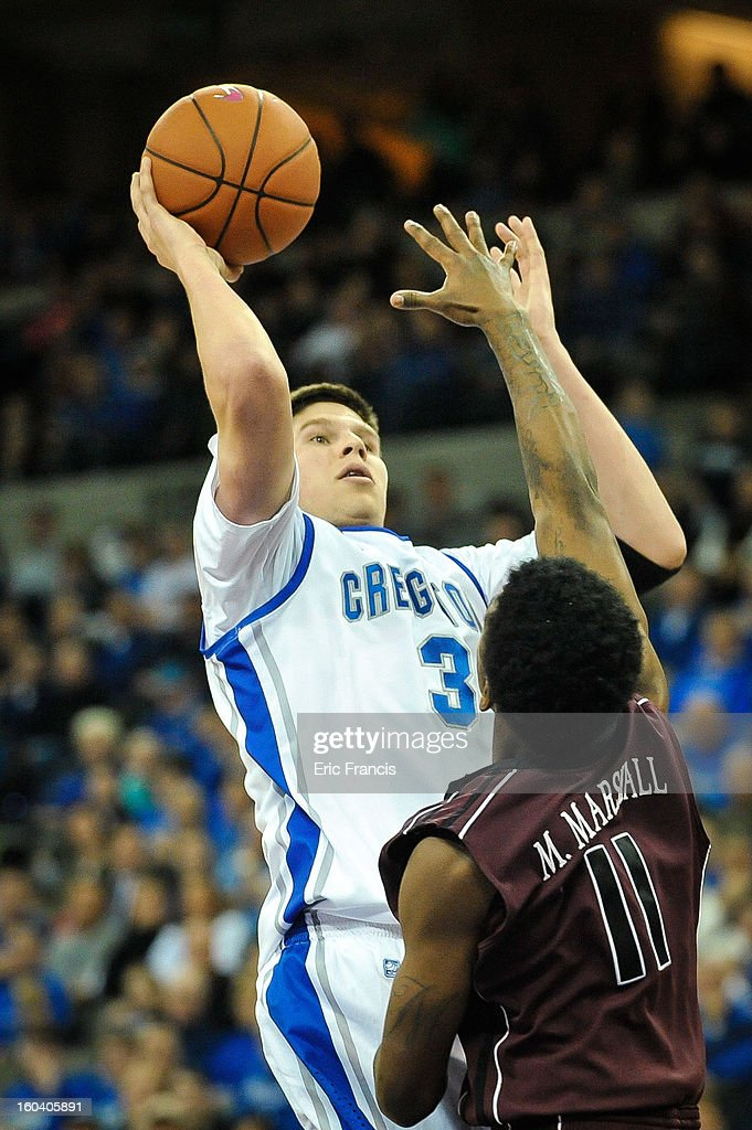 <a gi-track='captionPersonalityLinkClicked' href=/galleries/search?phrase=Doug+McDermott&family=editorial&specificpeople=7544468 ng-click='$event.stopPropagation()'>Doug McDermott</a> #3 of the Creighton Bluejays shoots over Marcus Marshall #11 of the Missouri State Bears during their game at the CenturyLink Center on January 30, 2013 in Omaha, Nebraska.