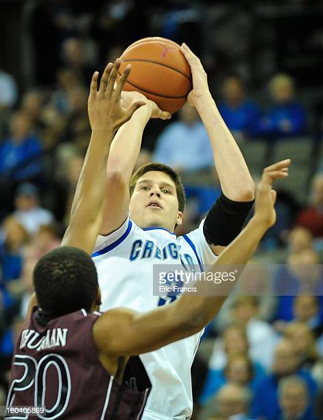 Doug McDermott of the Creighton Bluejays takes a shot over Gavin Thurman of the Missouri State Bears during their game at the CenturyLink Center on...