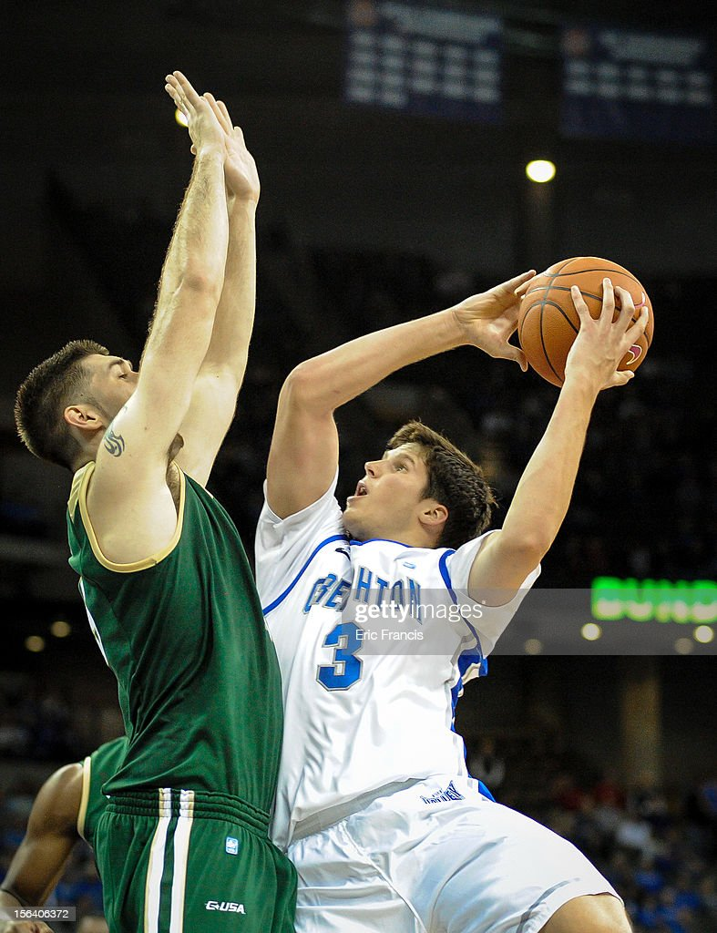 Doug McDermott #3 of the Creighton Bluejays tries to take a shot over Fahro Alihodzic #15 of the UAB Blazers during their game at CenturyLink Center on November 14, 2012 in Omaha, Nebraska.