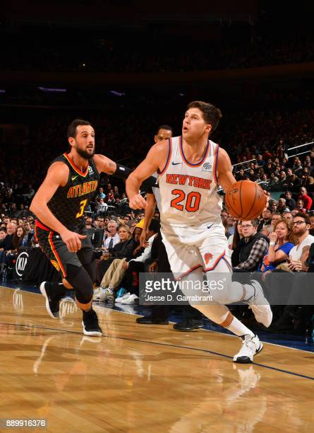 Doug McDermott of the New York Knicks drives to the basket against the Atlanta Hawks at Madison Square Garden on December 10 2017 in New York New...