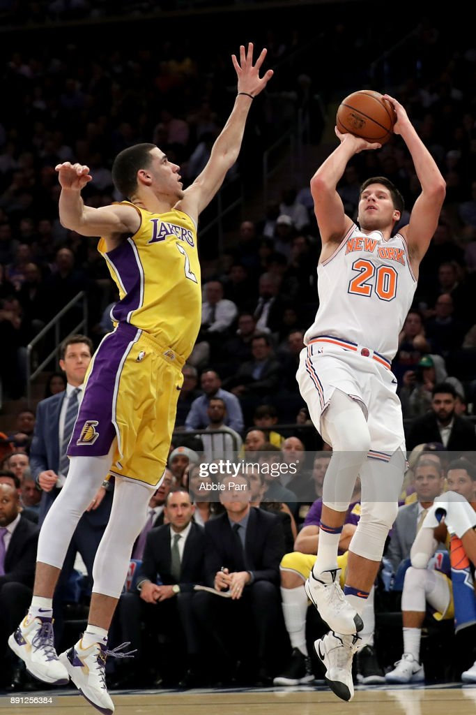 Doug McDermott #20 of the New York Knicks takes a shot against Lonzo Ball #2 of the Los Angeles Lakers in the fourth quarter during their game at Madison Square Garden on December 12, 2017 in New York City.